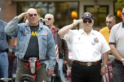 Vietnam War veterans Artie Rohrbacker, left, Sunbury, and Barry Mabus, Milton, salute during a Hometown Veterans Ceremony at Cameron Park in Sunbury on Saturday morning.