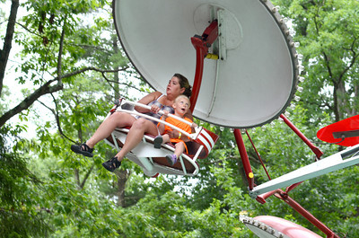 Brittany Stanger, left, Idaho, and Ella Hunter, 5, Idaho, enjoy the Parachutte ride at Knoebels on Tuesday morning.