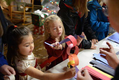 Savannah Hart, 5 of Milton, and Ava Mitchell, 4 of Millmont, make paper garland.