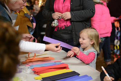Hannah Hunter, 3 of Dillsburg, picks out a colored strip of paper to make garland.