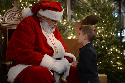 Tyler Kennedy, 3 of Milton, talks to Santa Claus about his Christmas wish list.