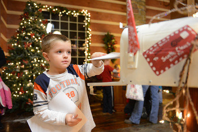 Thomas Bender, 5 of Catawissa, puts his letter to Santa Claus in a mailbox to the North Pole.