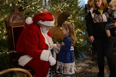 Zoey Gresh, 4 of Danville, talks with Santa Claus.