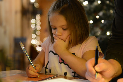 Brooke Fox, 7 of White Deer, thinks about what to write in her letter to Santa Claus.