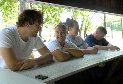 William Grove, 17, of Greenbriar, from left, Kelsea Rebuck, 15, Courtney Rebuck, 17, both of Herndon and Ryan Latsha of Herndon take a break from making the rounds at Line Mountain's Relay for Life at the Himmel's Church Grove Friday May 11, 2012 in Rebuck.