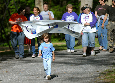 Cassie Snyder, 6, of Dornsife takes up the lead at the start of Line Mountain's Relay for Life at the Himmel's Church Grove Friday May 11, 2012 in Rebuck.