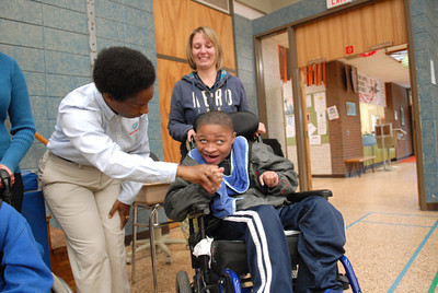 Loretta Claiborne, left, shakes hands with White Deer Elementary student Alnaim Kizis, 10, and Amy Lankford at the Baugher Elementary in Milton on Tuesday morning.