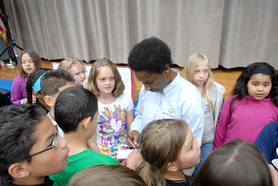 Milton Elementary School students at Baugher Elementary surround Special Olympic athlete Loretta Claiborne on Tuesday morning after she spoke at the school.