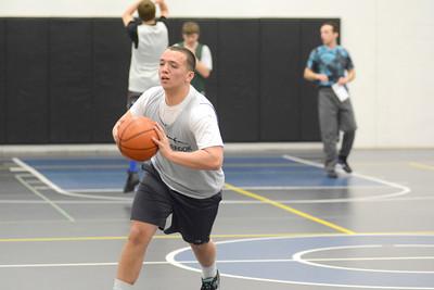 Meadowbrook Christian basketball player Logan Torrey makes a pass during Wednesday's practice.