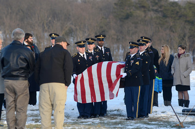 A Marine color guard unit carries the coffin of former state representative Merle Phillips at his burial site on Saturday.