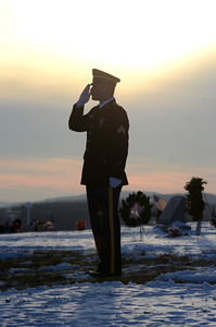 A Marine color guard memer salutes during the funeral service for Merle Phillips on Saturday.