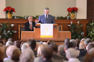 Michael Phillips speaks at his fathers, Merle Phillips, funeral on Saturday.