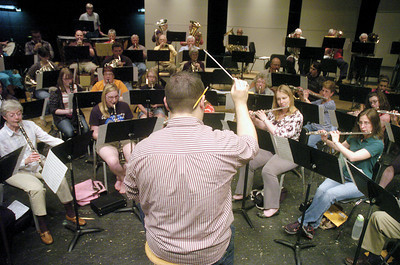 Brett Hosterman conducts the Milton Community Band, during rehersals on Tuesday night.  The band performs Saturday May, 5th at 7:30 in the Milton High School auditorium.
