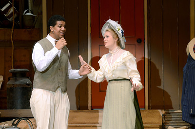 Milton High School students Aubyn Johnson, left, and Samantha Rohrer, take on the rolls of Horace Vandergelder and Dolly Levi in Milton's production of Hello Dolly.