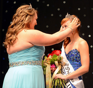 Amanda August/For The Daily Item Megan Rudloff is crowned the 2012 Milton Harvest Festival Princess by the 2011 Princess Elaine Waldron on Saturday night in Milton.