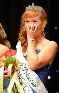 Amanda August/For The Daily Item Megan Rudloff wipes away a tear after being crowned the 2012 Milton Harvest Festival Princess on Saturday night in Milton.