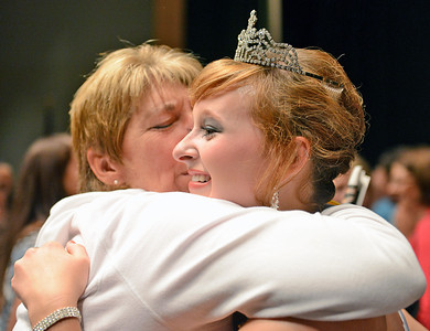 Amanda August/For The Daily Item Lisa McBryan, of Watsontown, gives a hug and a kiss to Megan Rudloff, the 2012 Milton Harvest Festival Princess, after the pageant on Saturday night in Milton.