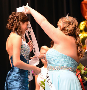 Amanda August/For The Daily Item Dana Kyle is crowned the Runner-Up of the 2012 Milton Harvest Festival Princess by the 2011 Princess Elaine Waldron on Saturday night.