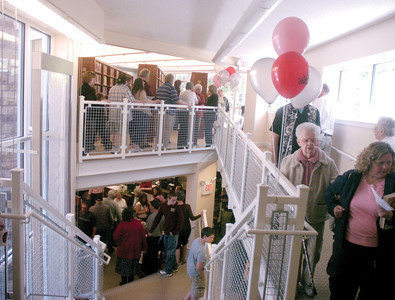 Vistors crowd the Milton Library during Sunday's open house.