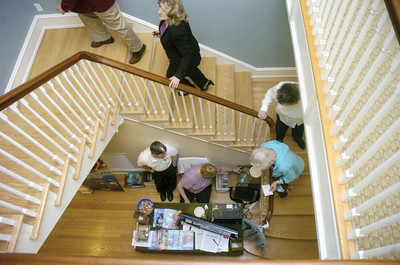 Visitors walk up to the third floor during Sunday's open house at the Milton Library.