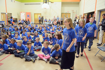 Montandon Elementary students go up to receive their Blue Ribbon certificates during an assembly on Thursday honoring the school for their achievement.