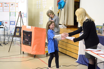 Montandon Elementary fourth grade student Emma East gets her Blue Ribbon certificate from her teacher Sony Ferguson at an assembly on Thursday to honor the school for achieving Blue Ribbon status.