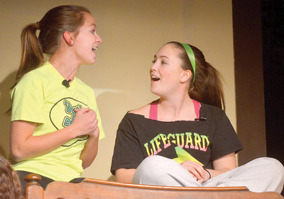 "Tara Demko as Marty and Isabella Stellar as Jan sing ""Freddy, My Love"" during a Mount Carmel High School rehearsal of the musical ""Grease."" The musical  will be held at 7:30 p.m. March 15 and 16 at the Mount Carmel Area Junior-Senior High Schoo Auditorium."