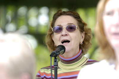 LaVina Truslow, Sunbury, sings with the Faith United Methodist church choir during a National Day of Prayer gathering Thursday in Cameron Park.