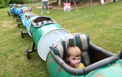 Grace Johnson, 3, of Augustaville waits for the tractor train to take off during the Northumberland County Fair Friday August 24, 2012 in Sunbury.