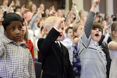 Northumberland Christian School students Caedmon Milinovich, left, and Joshua Schmitt, sing a song during the school's Spring Program on Friday.