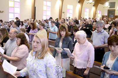 Family and friends join in singing during the Northumberland Christian School's Spring Program on Friday morning.