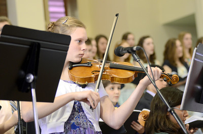 Northumberland Christian School student Hannah Renno plays the violin during the school's spring program on Friday morning.