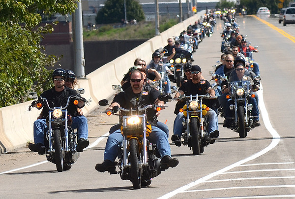 Todd Heller and Ashley Brown lead the hundreds of supporters on bikes and in cars accross the Veterans Memorial Bridge for the Kirk and Mayson Memorial Ride and Benifit Saturday Sept. 15, 2012.