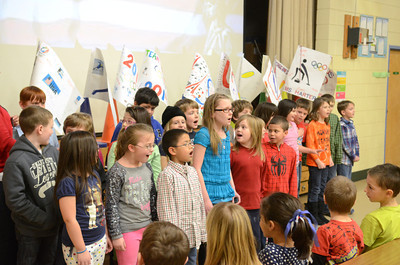 Montandon Elementary second grade students sing the American National Anthem during a assembly on Friday to kick off the school's Olympic reading challenge.