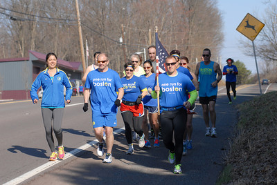 Local runners Beatrice Benedit, left, Doug Alter, Nancy Lee Harmon, Sonya Crane, and Nathan Fisher, start off with others on their leg of the One Run For Boston run on Thursday morning on Route 61 in Stonington.