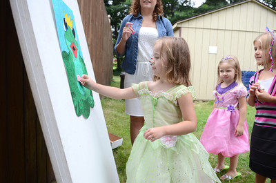 Ashlyn Passmore, 4, pins lips on a frog at the Priestly Library during a princess day activity as Allie Wertz, 3, watches on.