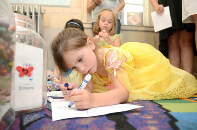 Bryleigh Gill, 4, colors a crown during princess day at the Priestly Library in Northumberland on Friday.