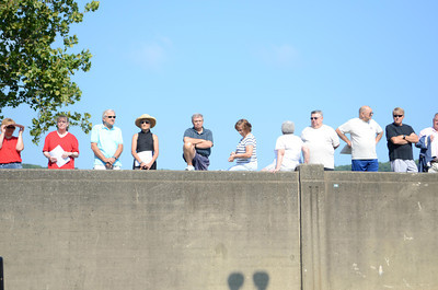People watch the re-dedication ceremony of Merlel Phillips Park from the wall at the recently completed Sunbury river front project on Thursday morning.
