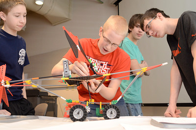 Danville 8th grade students Brenan Ryan, 14, left, Caleb Stassel, 13, Bradley Yeich, 14, and Dylan Smith, 14, work together on their Knex vehicle during a STEM competition on Monday at the CSIU in Milton.