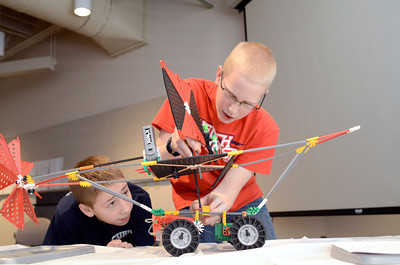 Eight grade student's from Danville, Brenan Ryan, 14, left, and Caleb Stassel, 13, try to attach the sail to their wind powered land boat during a STEM competition on Monday at the CSIU in Milton.