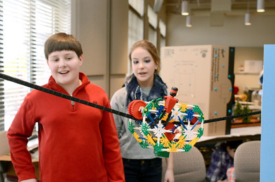 Southern Columbia 6th grade students Erick Shufeldt, 12, left, and Mikaela Brouse,12, watch the progress of their cable car on Monday at a STEM competition with Knex at the CSIU in Milton.
