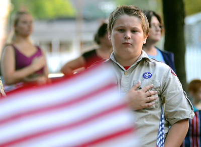 Anthony Matusek, a member of Troop 325 out of Northumberland, stands at attention for the Pledge of Allegiance during the September 11th Memorial Tuesday in Northumberland.