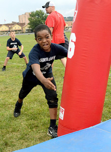 Tumaje Islam, 9, of Shamokin Township gets his game face on during the Shikellamy Youth Football Skills Camp Friday July 27, 2012.