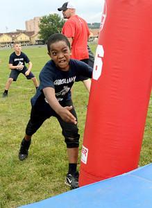 Tumaje Islam, 9, of Shamokin Township gets his game face on during the Shikellamy Youth Football Skills Camp Friday July 27, 2012.