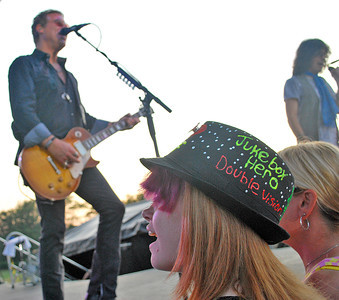 Amanda August/For The Daily Item Nikki Harrison, 17 of Maryland, sings along with Foreigner during their concert at Spyglass Ridge Winery outside of Sunbury on Saturday night.