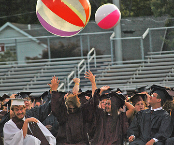 Amanda August/For The Daily Item Members of the Shikellamy High School senior class throw beach balls into the air during the commencement ceremony on Friday night in Sunbury. The beach balls are a tradition during the ceremony.