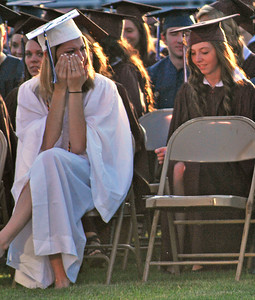 Amanda August/For The Daily Item Evelyn Pehowic cries during the speech of valedictorian McKensie Haines, after Haines told a story of Pehowic helping her to spell her name in Kindergarten, during Shikellamy High School's commencement ceremony on Friday night in Sunbury.