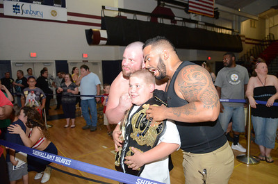 Nathan Faubion, 10, Milton, has his picture taken with The Administrations AC Anderson and Havoc at the WXWC4 Shikellmay Showdown on Saturday.
