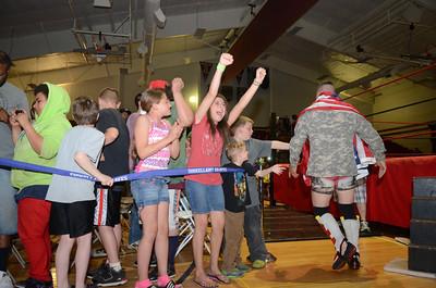 Breanna Dane, 10, left, Sunbury, and Alyssa Lamberson, 11, Sunbury, cheer on at the start of a match during the WXWC4 Shikellamy Showdown on Saturday.