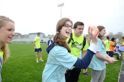 Midd-West special education student Courtney Troxel, left, throws a water balloon with help from Warrior Run High School student Zach Burrows on Friday during a special education field day at the Warrior Run High School football field.
